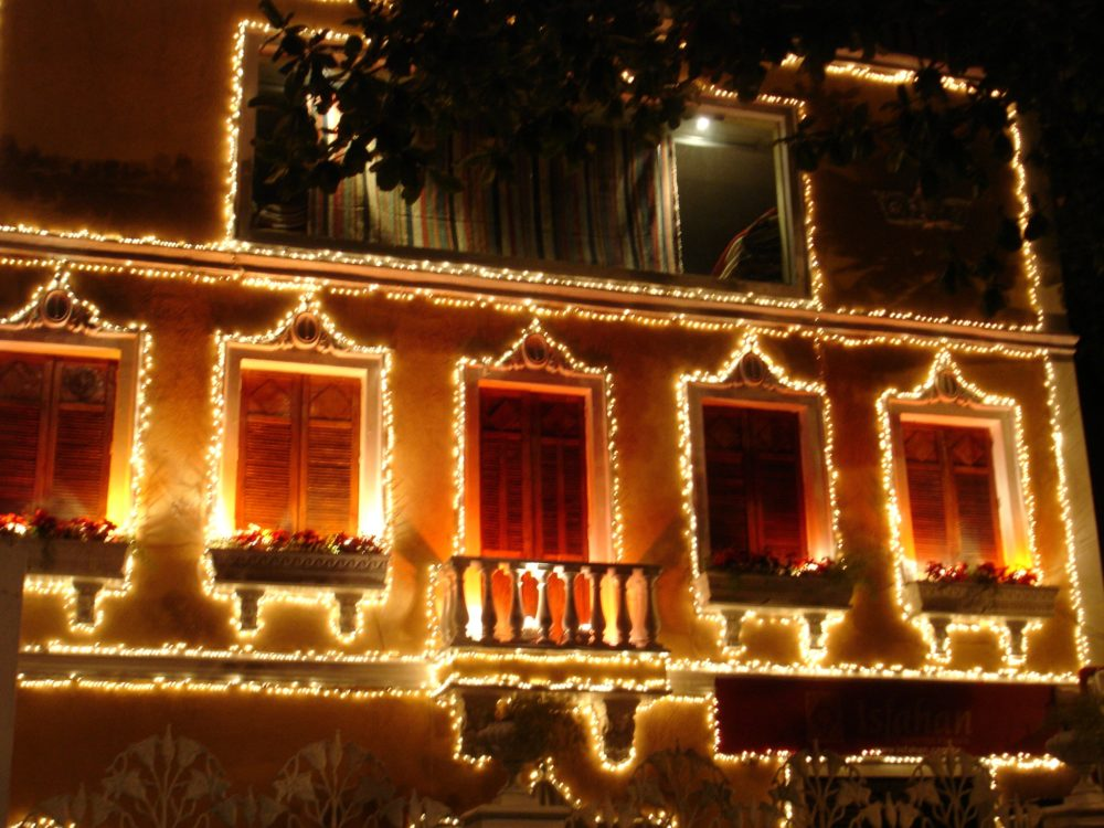 a house decorated in lights on Copacabana beach