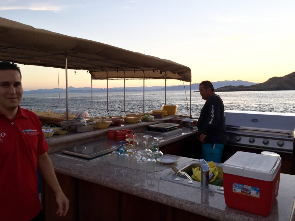 the chef cooking on the upper deck of the rocio del mar