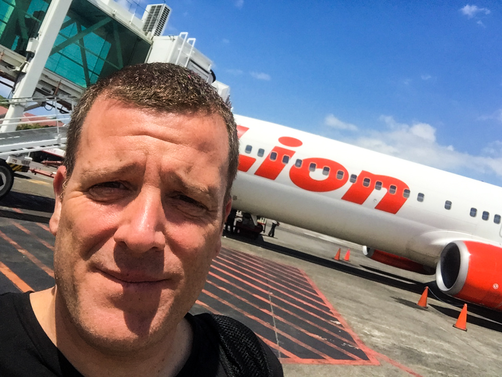 How to get to Raja Ampat - Michael standing next to a Lion Air plane
