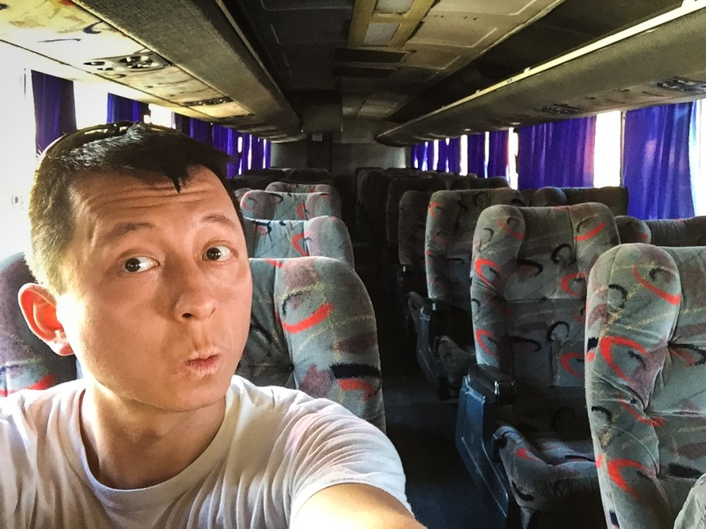 Belize City to Tikal - inside the bus. Halef is the ONLY passenger