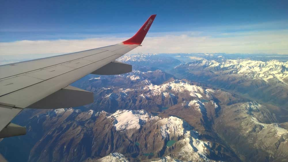 Airplane wing looking out over mountains