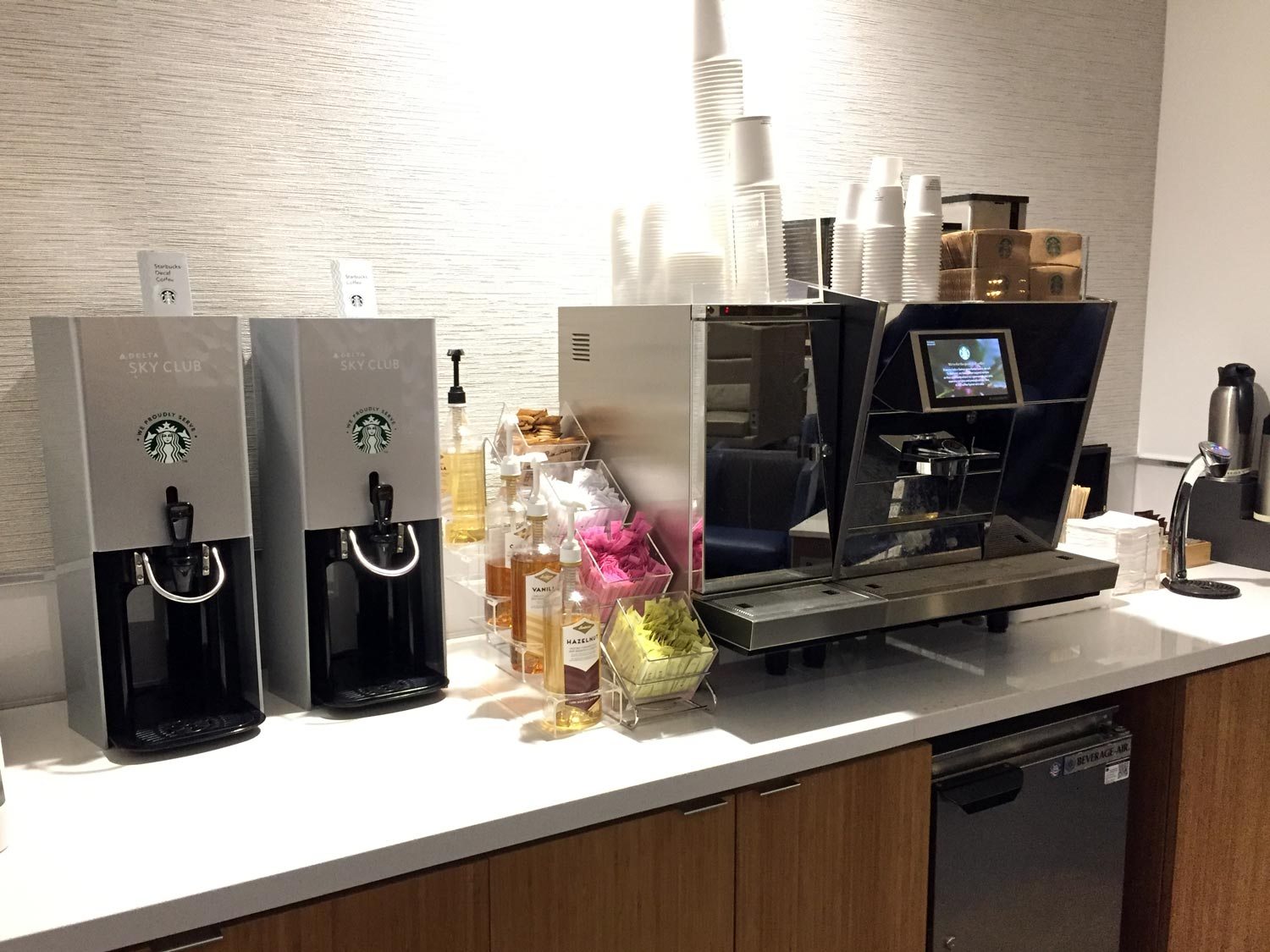 The typical Starbucks coffee station common to Delta Sky Clubs