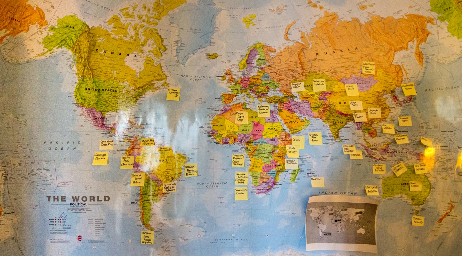 ultimate round the world bucket list map with sticky notes