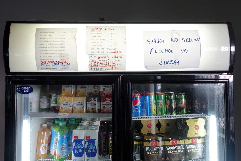 Aitutaki culture no alcohol on sunday sign