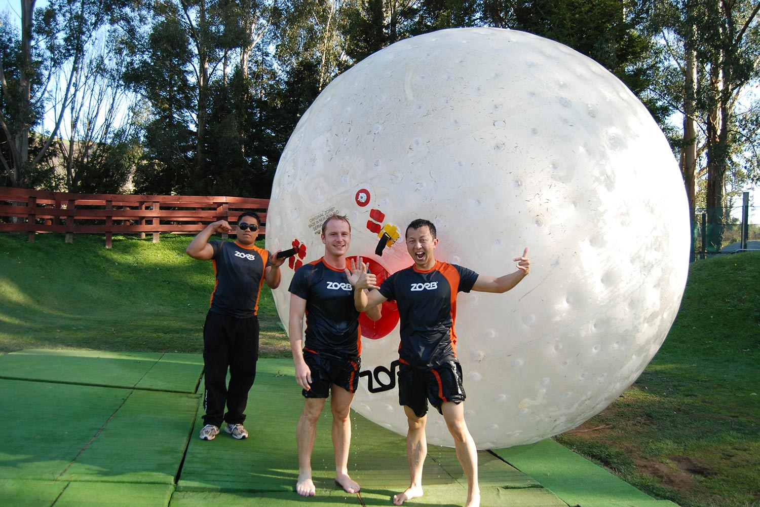 Halef and a friend standing in front of a giant Zorb ball