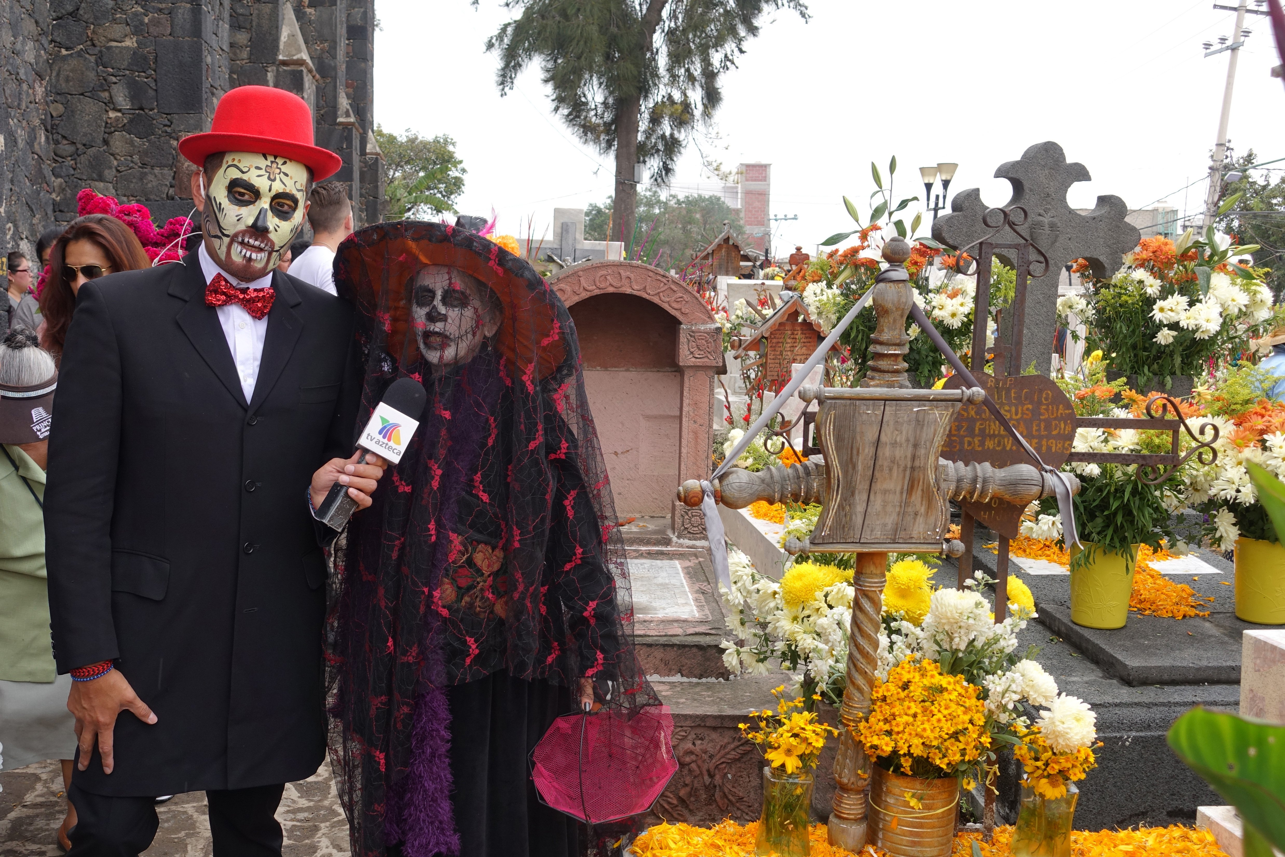 Day of the dead mixquic - a local news crew in full costume
