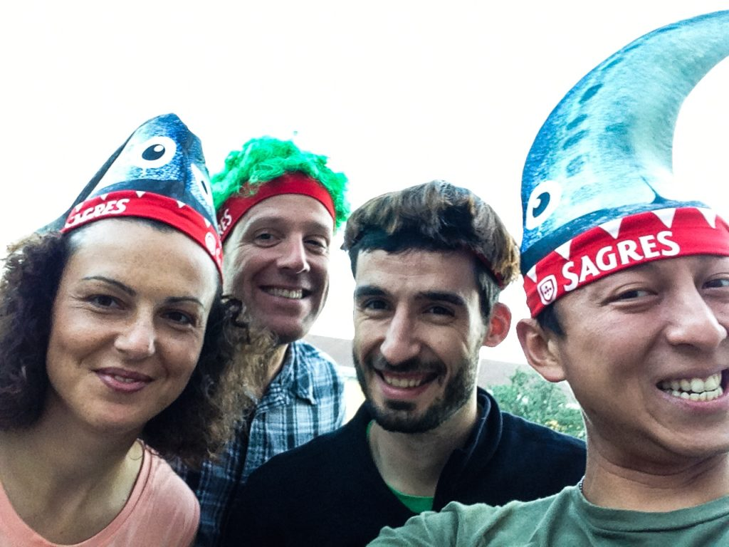 Michael, Halef, and friends wearing Sagres beer hats