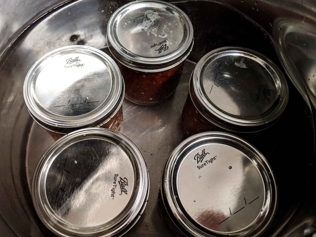Mason jars in a pot of boiling water