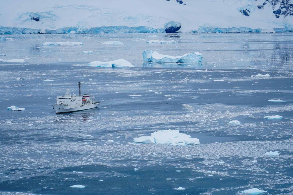 The Akademik Ioffe anchored in a sea of ice in Antarctica