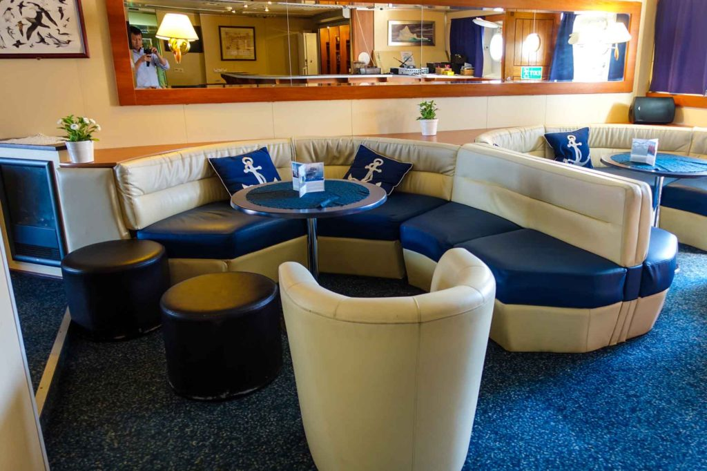 The lounging area at the bar - sectional sofas and swivel plush chairs