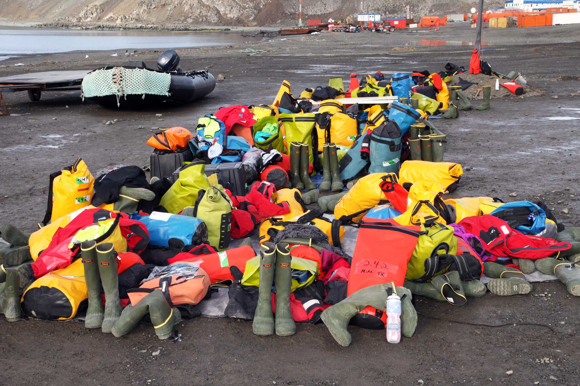 Piles of gear at the antarctica marathon starting line
