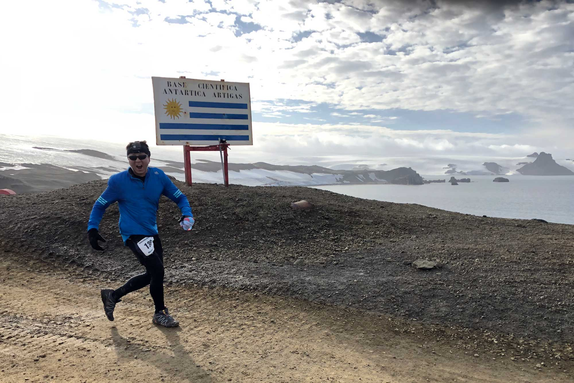 Halef running past the Uruguay Base sign