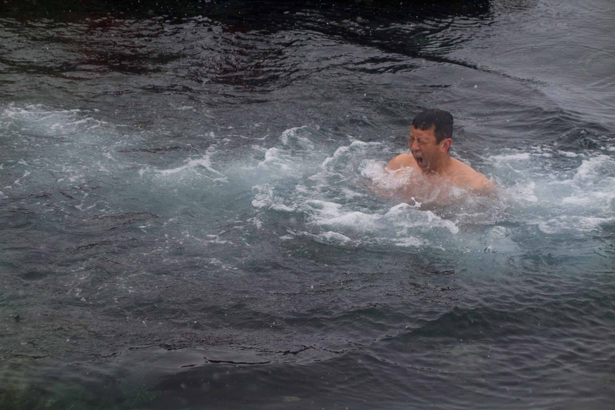 Halef taking a polar dip in the waters of Antarctica