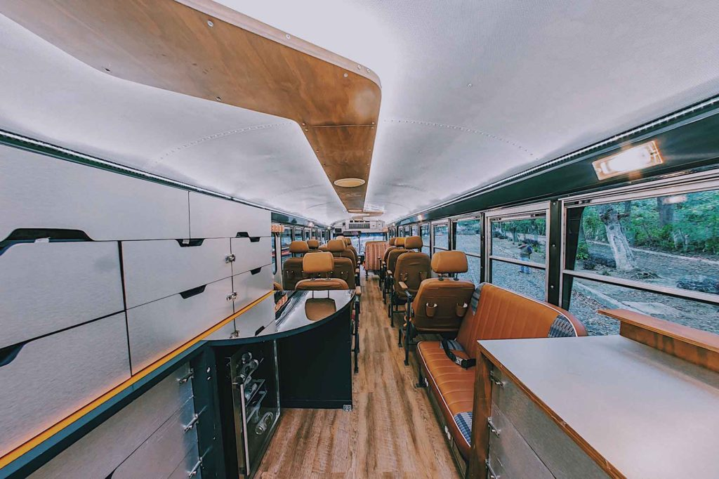 Wide angle view of the interior of the bus from back to front showing the bar area.