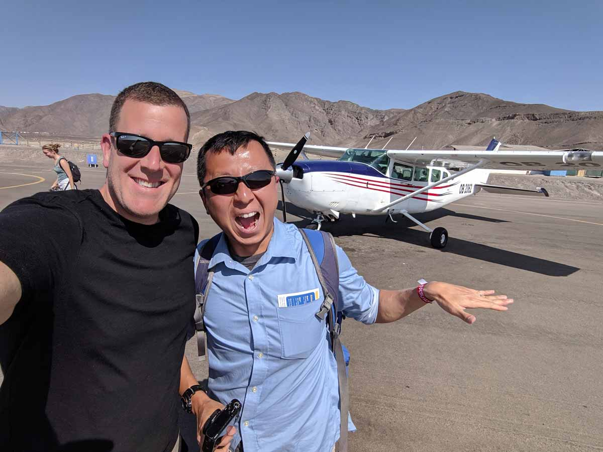 Michael and Halef posing in front of the Cessna that flew them over the Nazca lines.