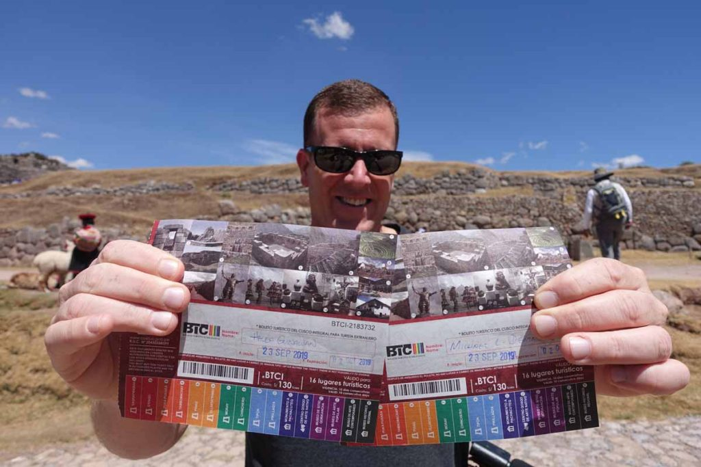 To do a day trip to Pikillacta, you need the Cusco Tourist Ticket. Michael holding up two tickets.