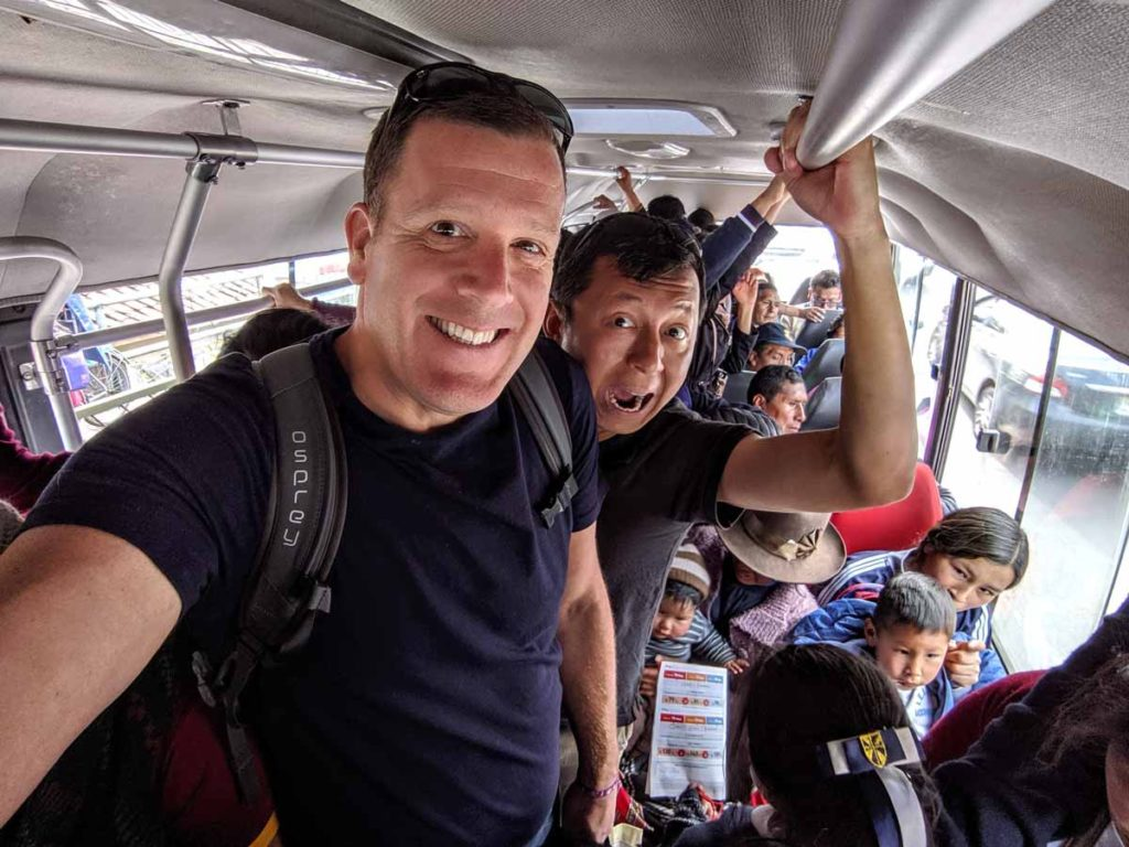Our best Cusco travel tip is to learn to use the buses. This is us inside a Cusco bus.