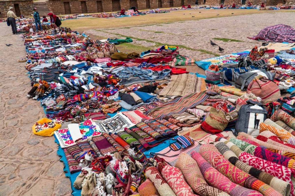 Colorful woven fabrics for sale in Chinchero. Combine Chinchero, Moray, and Maras as a day trip from cusco