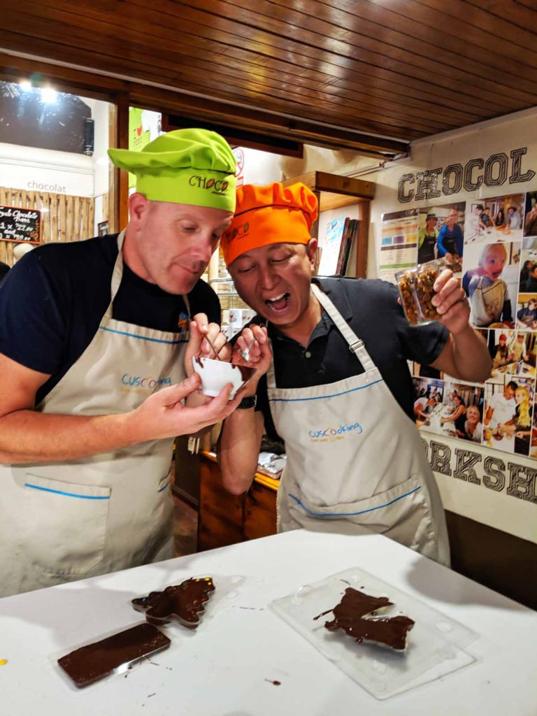 Michael and Halef making chocolate wearing ChocoMuseo aprons and chef hats.