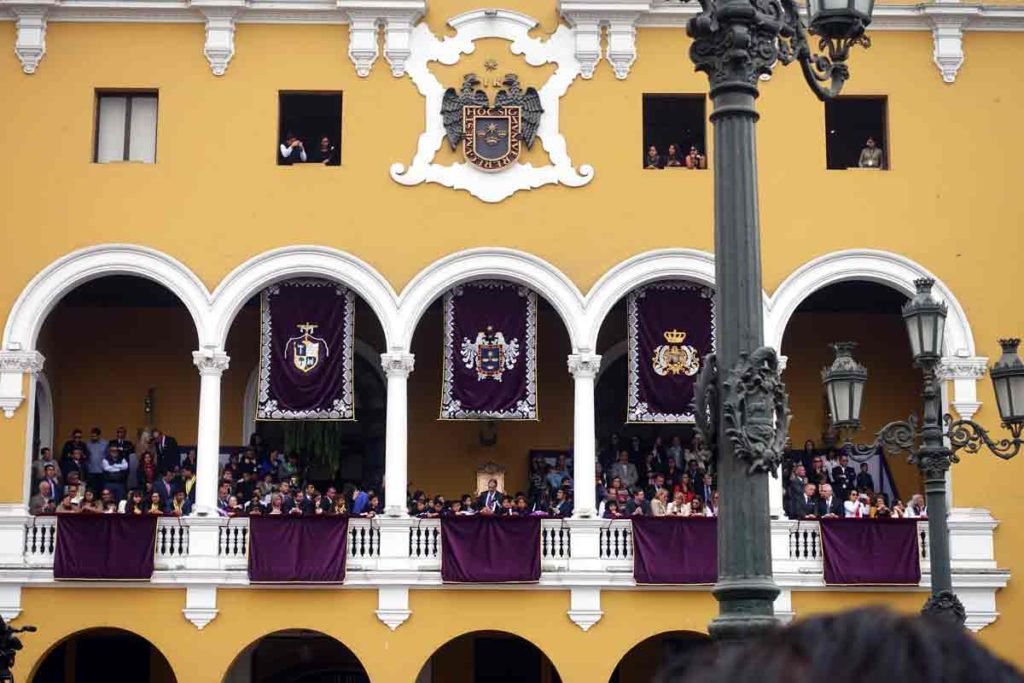 Dignitaries sitting in a balcony in plaza mayor in central lima