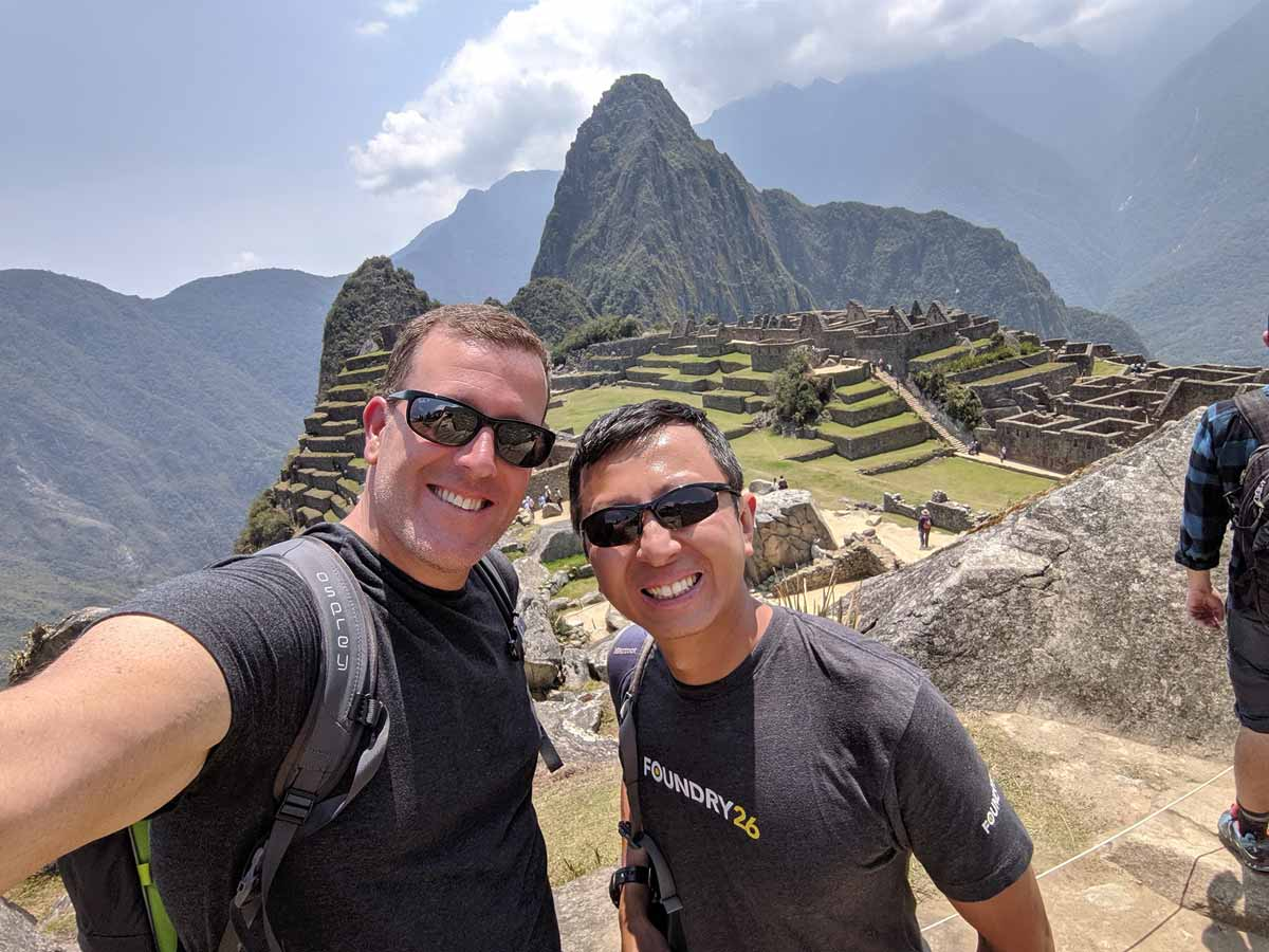 Michael and Halef selfie above Machu Picchu on a perfectly clear day.