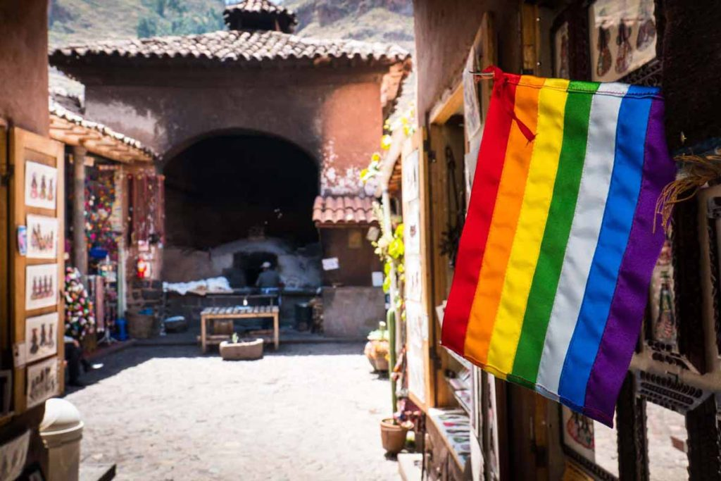 Rainbow flag in Pisac Market. The flag contains 7 colors.