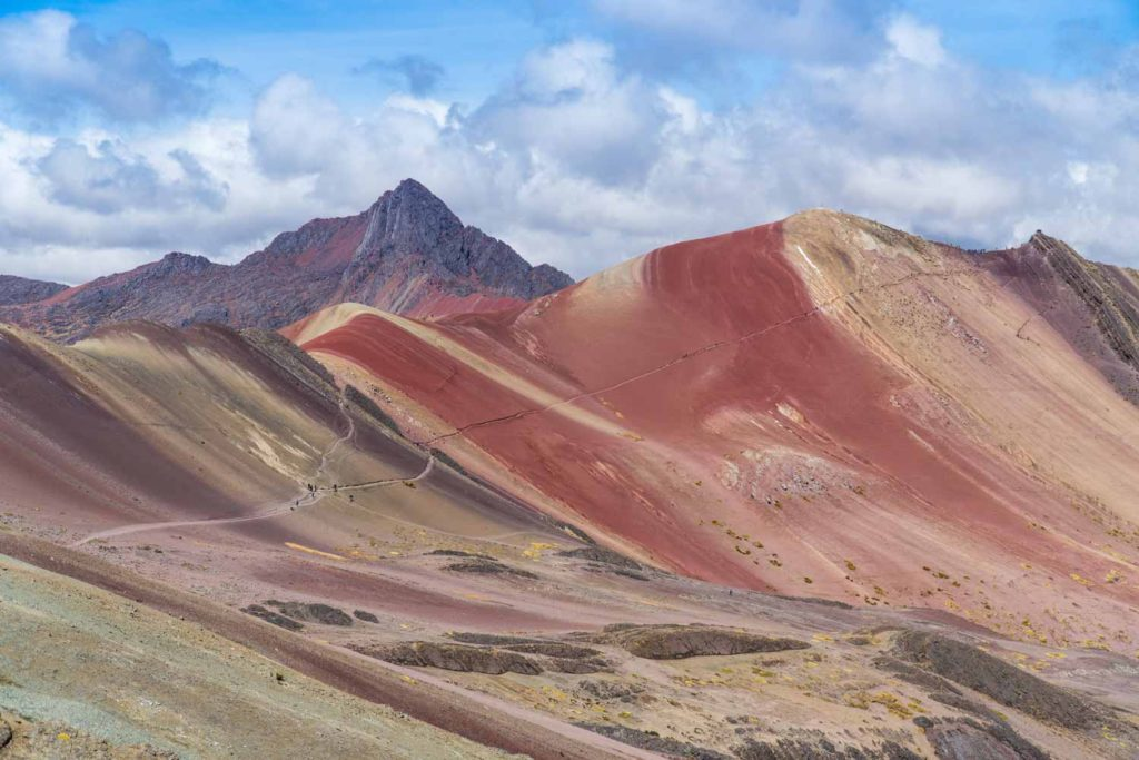 rainbow mountain and the surrounding red valley - wide angle