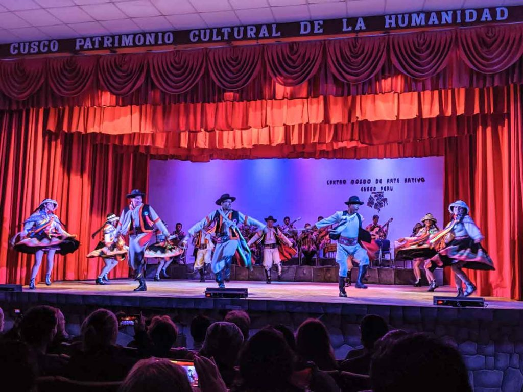 A group of dancers performing at the Cusco Native Arts Center theater.