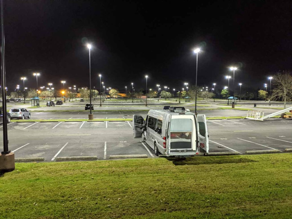 Our van at night, boondocking at a casino in Louisiana