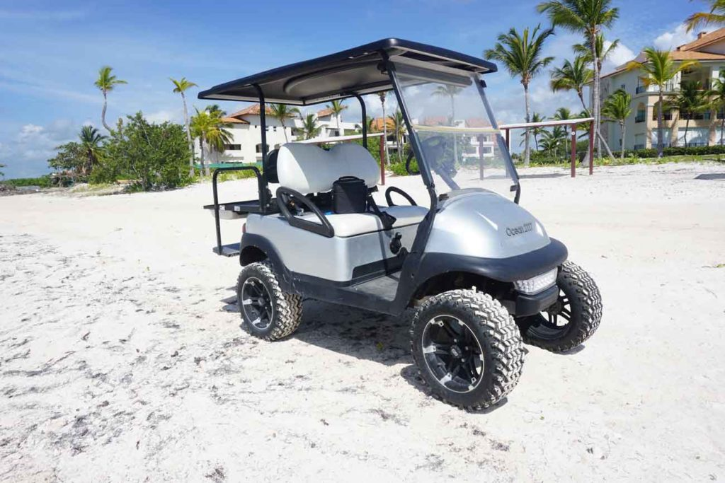 A golf cart on a beach. Golf carts are common ways to get around in Vieques. It's how we did it and it worked fine.