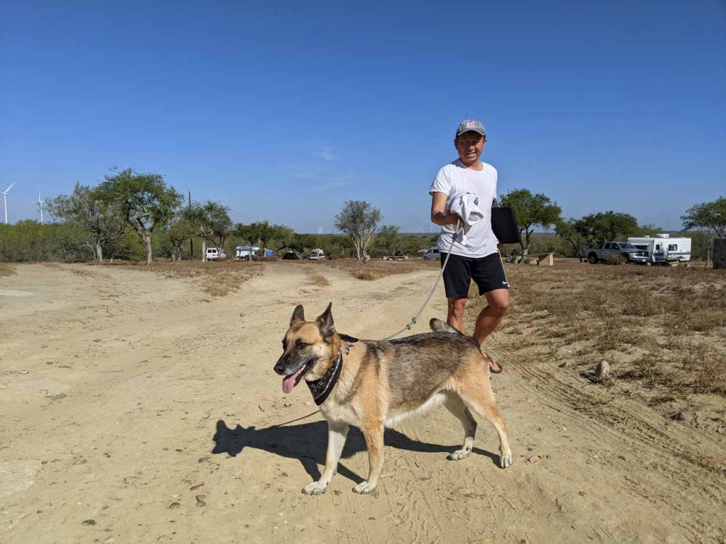 Halef walking Kana at Falcon County RV Park