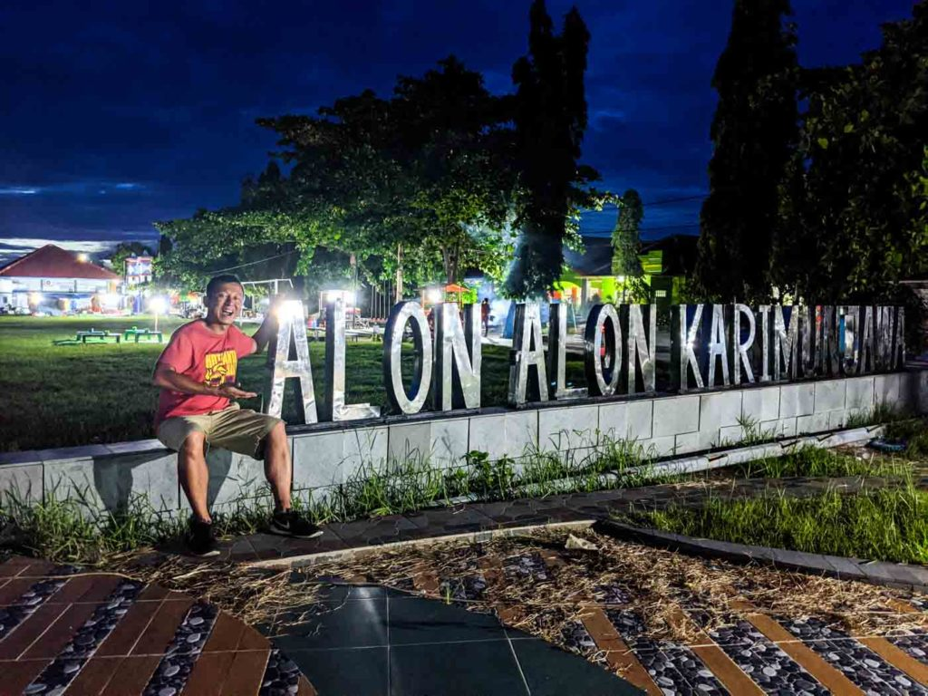 One of the best things to do in karimunjawa is to visit the night market, or alon alon. Halef is sitting next to the silver sign at Alon Alon.