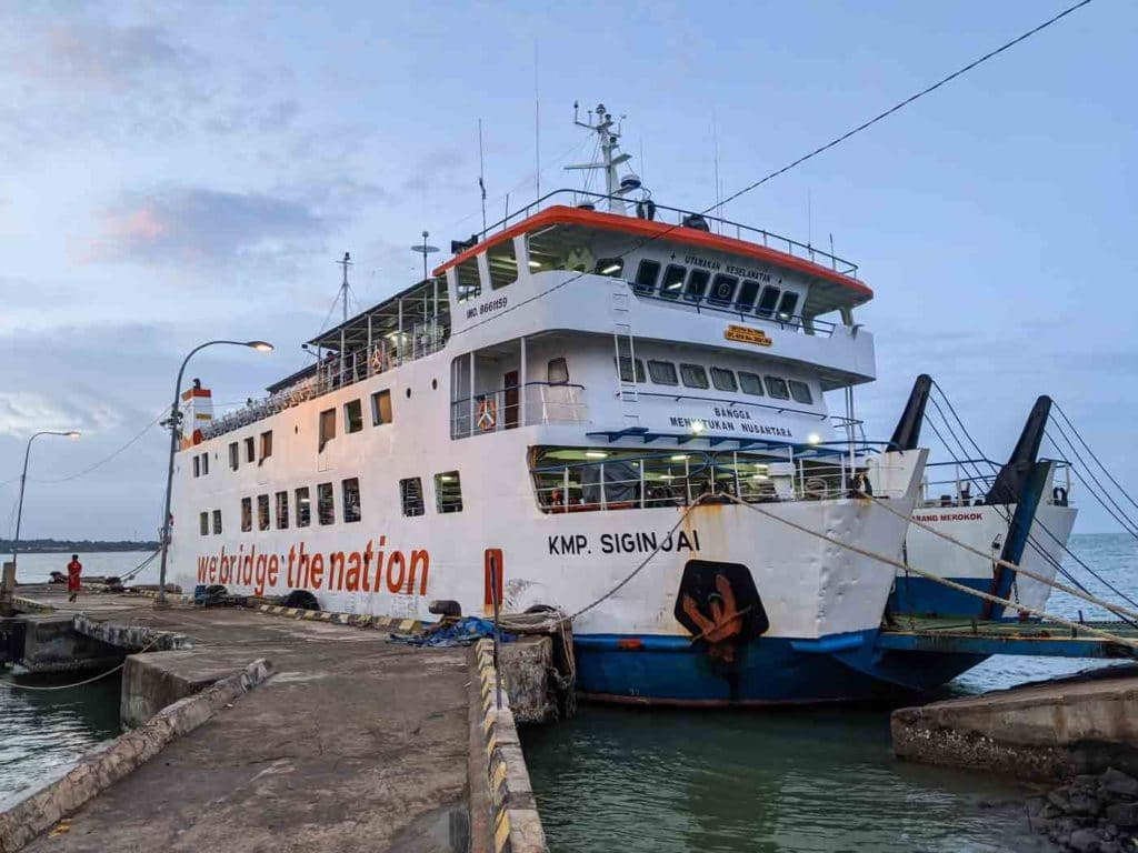 "The Siginjai Karimunjawa ferry with the words ""We Bridge the nation"" on the side"