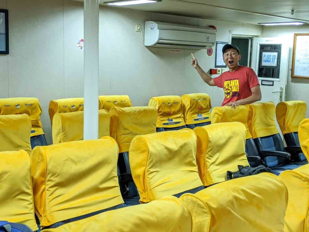 The VIP section of the Karimunjawa Slow Ferry with yellow airplane style seats and air-conditioning