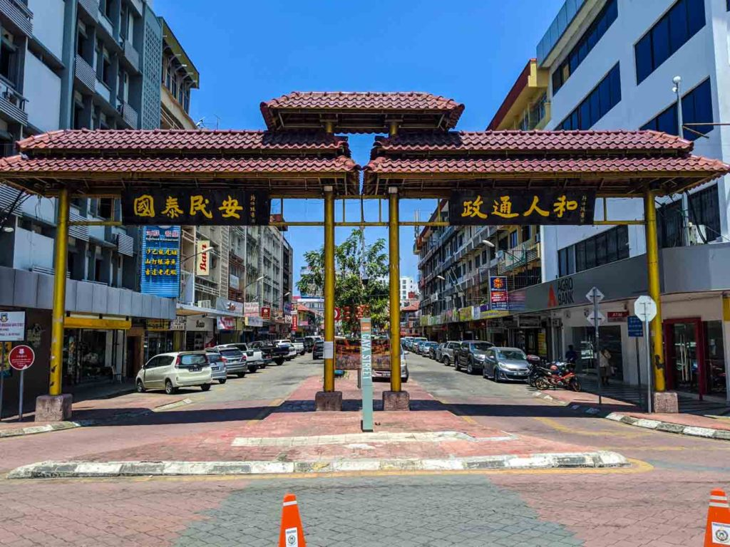 The gate of Chinatown in Kota Kinabalu. Pretty typical looking gate, except it's brown instead of red.