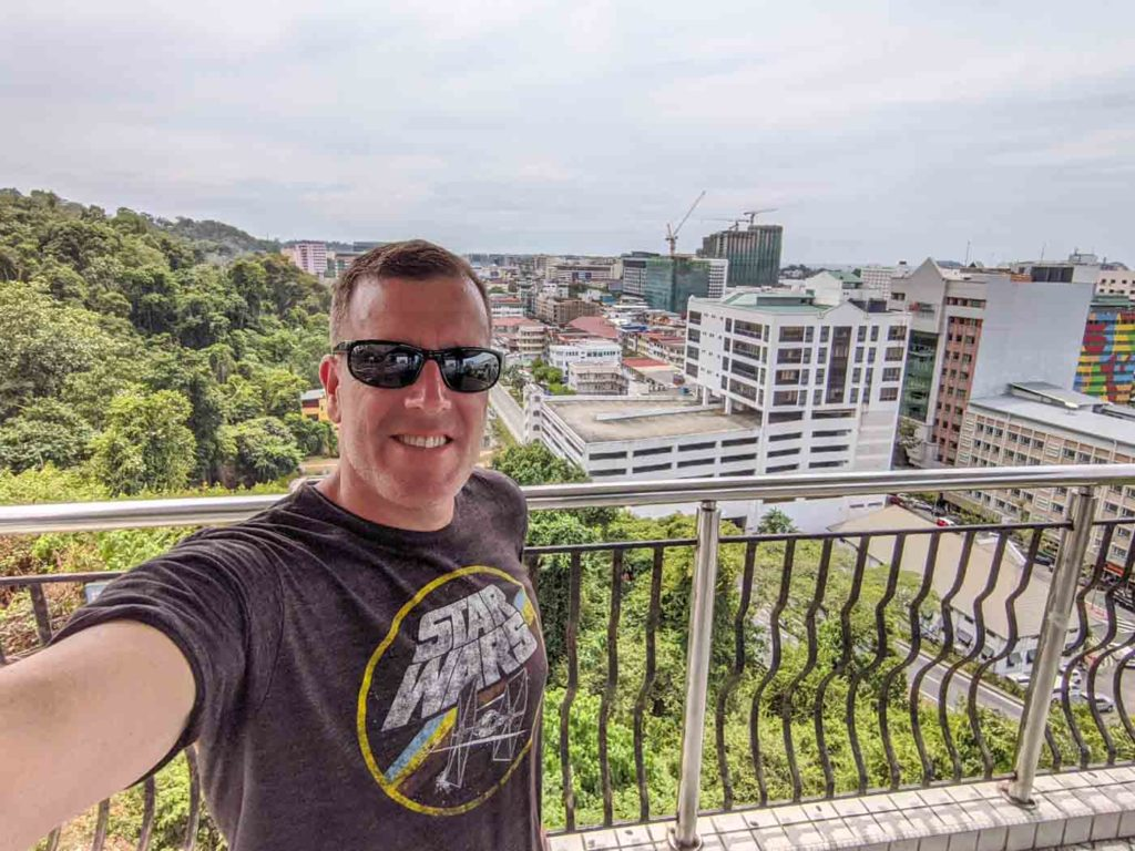 Michael selfie from the top of the Kota Kinabalu observatory with the city in the background.