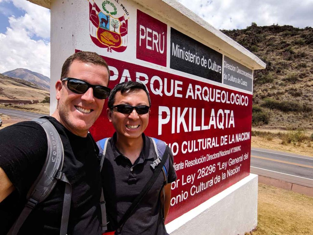 Michael and Halef in front of the Pikillacta Archaeological Park sign