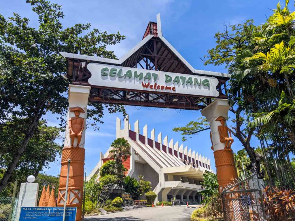 "One of the top things to do in Kota Kinabalu is the Sabah State Museum. This is the entrance to the Sabah state museum with a sign that reads ""Selamat Datang - Welcome"""