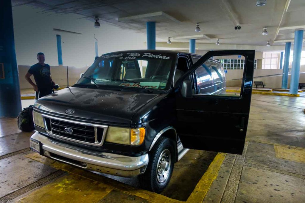 A black ford full-size van - the publico that took us from San Juan to the Vieques ferry terminal.