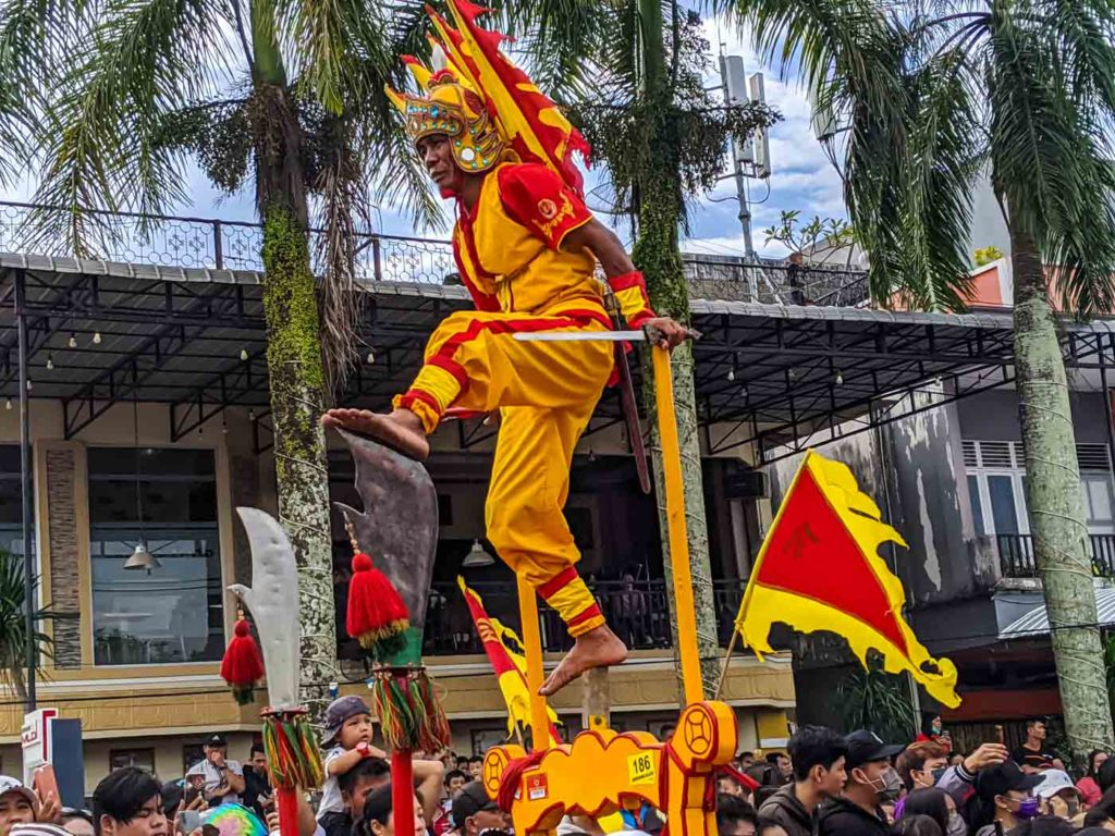 One of the tatungs of the singkawang cap go meh festival standing on sharp blades.