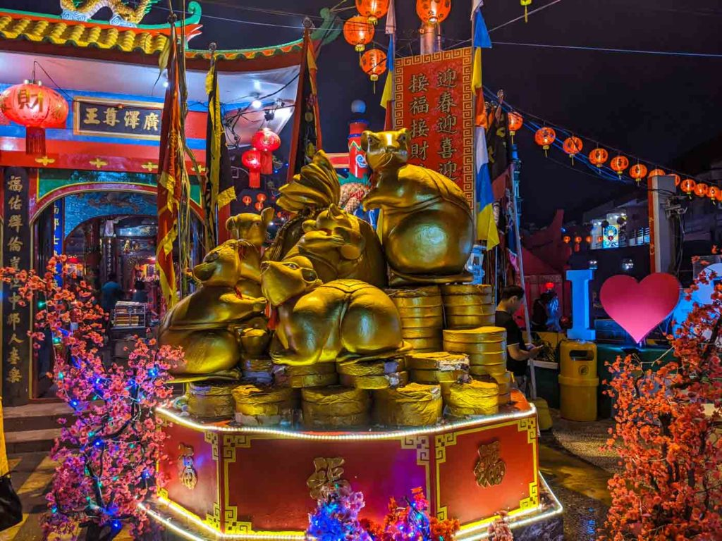 2020 is the year of the rat. This is a statue of a group of golden rats at the Singkawang cap go meh festival.