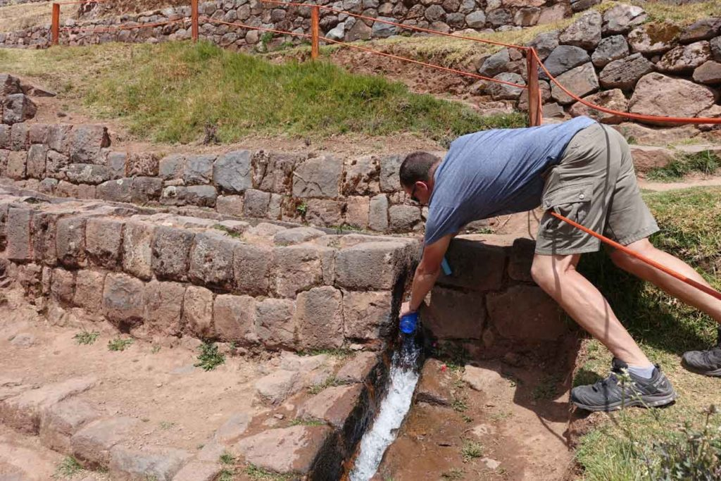 Michael collecting water from the irrigation system in his Lifestraw Go bottle