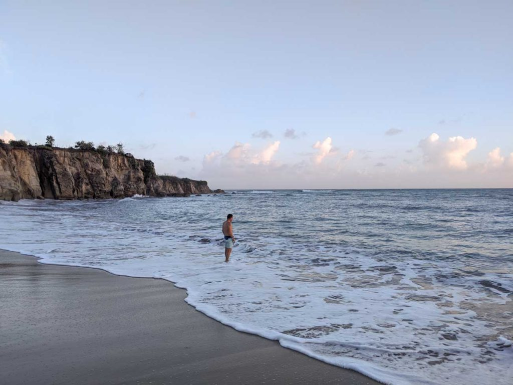 If you have time at the end of your Vieques 3-day itinerary, check out Black sand beach. This is Michael standing in the water at Black Sand beach in Vieques